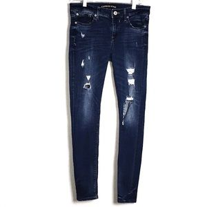 EXPRESS RIPPED MID RISE LEGGING SKINNY JEANS